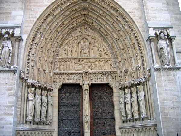 The door of Santa Ana, with the arabesques of iron on the wood that Biscornet would have made.