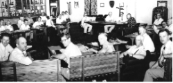 People sitting around on couches and looking at the camera.