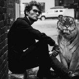 James Apollo with a large cat added to the picture with Photo Shop