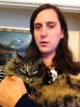 "Here's Stacy from Childbirth with her cat Peggy, who she describes as "" a beautiful dark angel"""
