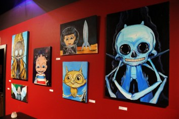 Xavier Lopez Jr. paintings hang during NadaMucho.com's #41for2015Fest at Substation.