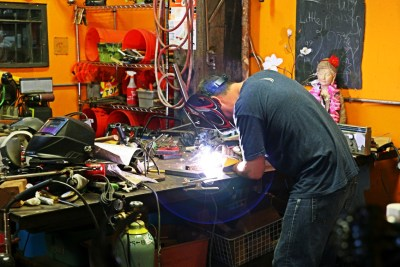 Every music festival should have a guy welding in one of the rooms