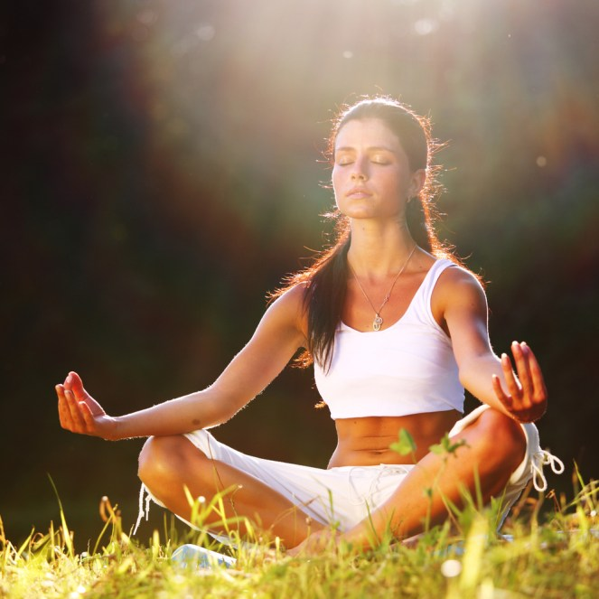 girl sitting doing yoga