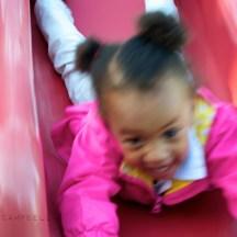 Girl on slide in Colgate Park