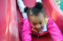 Girl on slide in Colgate Park