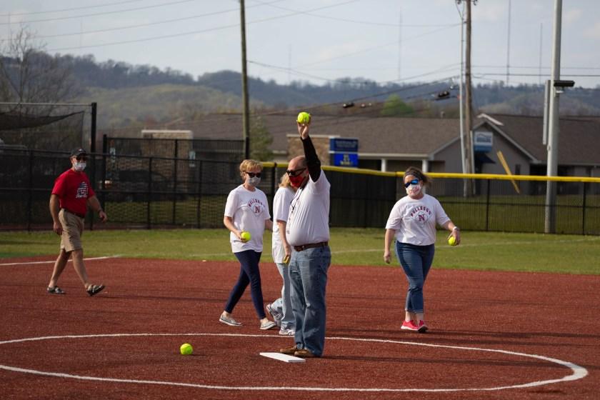 Joe Brown prepares to pitch a softball