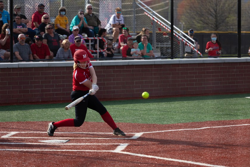 New Albany softball player gets ready to make contact with the ball