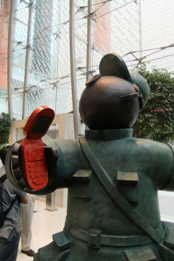 Going Forward! Making Money, Closed-up view of one Red Guard, holding a mobile phone