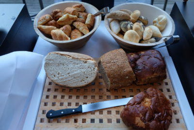 Breakfast At Hotel Montanus, Wide Chocolate Fondue Fountain Among Breakfast Buffet Spread - Bread & Pastries