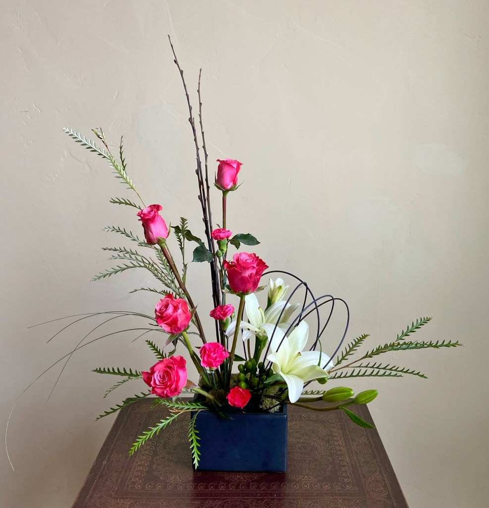 Contemporary Design with Salmon Color Roses and White Lilies