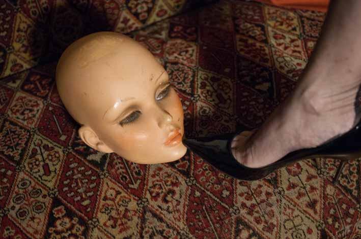 Mask and stockinged feet
