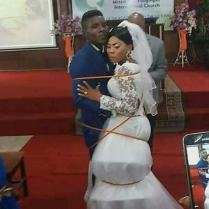 """""""What God Has Joined Together"""": Pastor Ties Couple Together With Rope At The Altar"""
