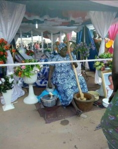Shocking! Dead Woman Made To 'Pound Yam' During Her Lying-In-State (Warning: Scary Photo)