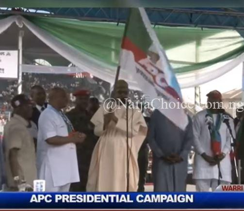 ''I Hand Over This Flag To Our Governortorial Candidate' - Watch As Buhari Publicly Goofs Again In Warri