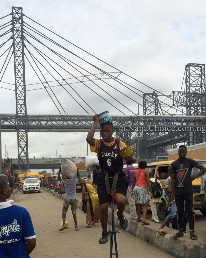 Wow! Young Girl Filmed Performing Incredible Stunts In Oshodi, Lagos (Video)