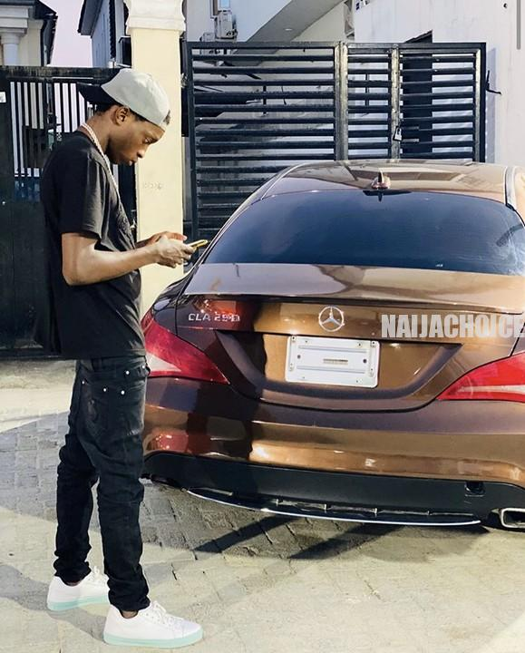 Naira Marley Buys A Mercedes Benz CLA 250 For His 19 -Year - Old Brother