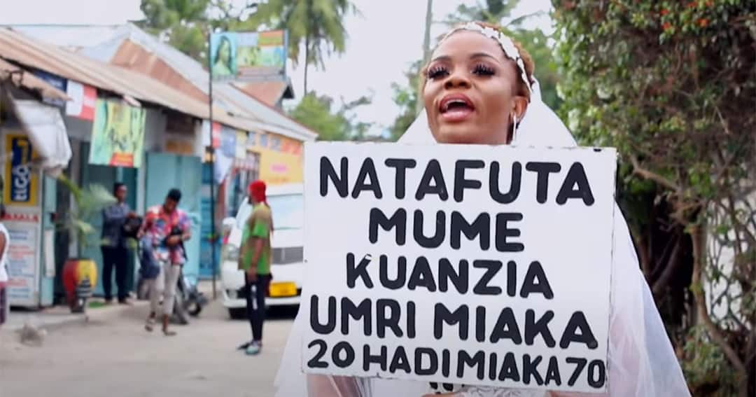 Fine Lady With Placard Storms Streets In A Wedding Gown In Search Of A Husband (Pix)