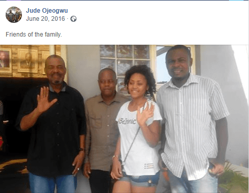 Picture of Regina Daniels & her supposed father in the middle, standing with family / friends