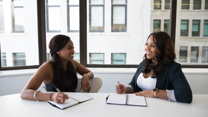 two African women discussing business