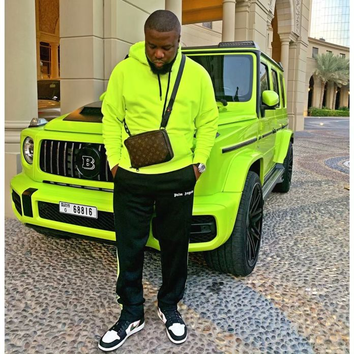 Raymond Igbalodely shows off his green Mercedes Benz G700.