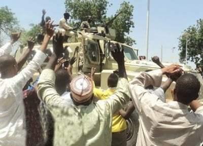 Nigerian troops celebrate after killing hundreds of Boko Haram men in Konduga