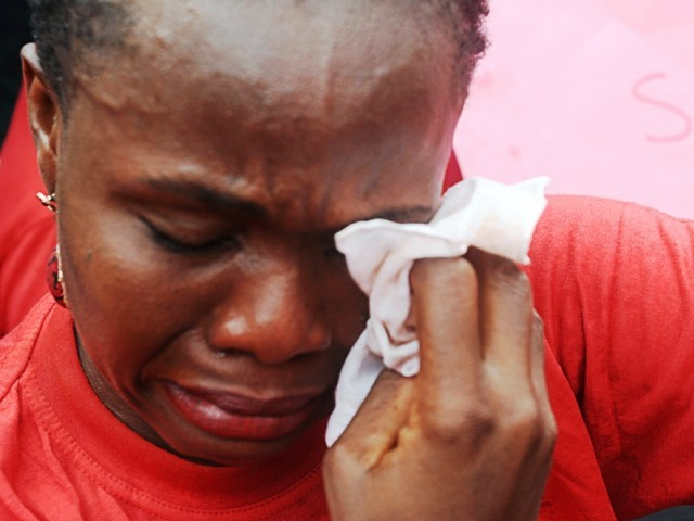 Image result for nigerians crying  JUST AFTER INNOSON WON BATTLE AGAINST GTB, MAN CLIMBS VERY HIGH MAST, CRASHES INTO BANK THROUGH THE ROOF IN IBADAN [VIDEO] students crying