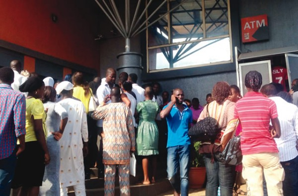 Customers-waiting-for-revalidation-of-their-Bank-Verification-Numbers-at-a-bank-branch-at-Awori-on-Lagos-Abeokuta-Expressway-Lagos...-on-Tuesday