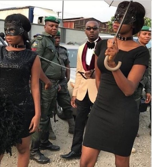 """Popular Lagos Socialite """"Pretty Mike"""" Chains Two Girls Like 'Local Dogs' To A Party (Photos+Video)"""