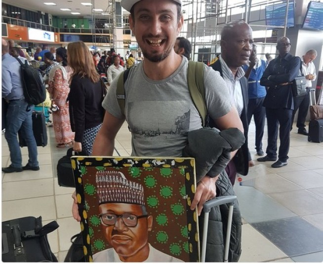man 4 - Oyinbo Man Spotted With Buhari's Painting At Lagos Airport   See What He Said