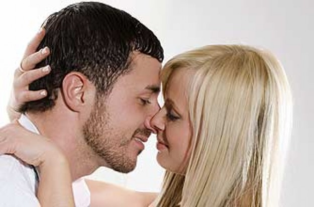 a man kissing a woman - Where Are The Guys? Check Out The Ways To Woo A Girl Without Using Money