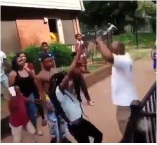 OMG: Man Hits Hammer on Young Lady's Head During A Crowdy Fight (Watch Video)