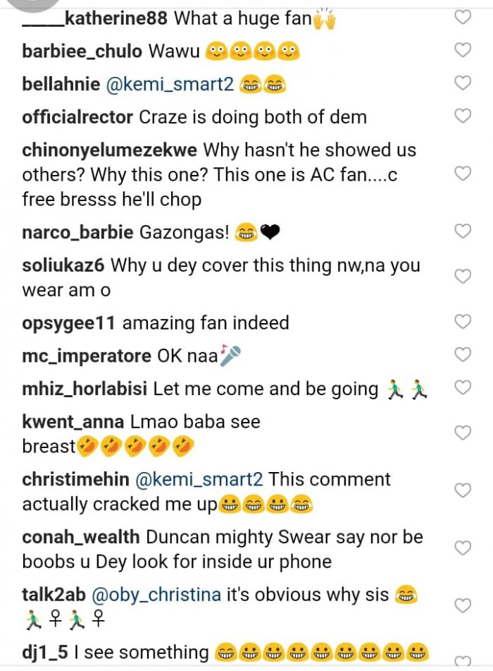 Duncan Mighty Meets His Massive Cleavage-Baring Fan (See Reactions) 3