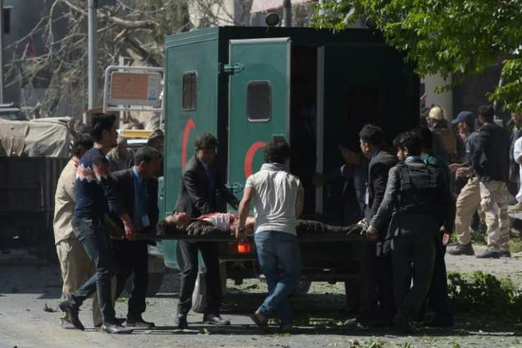 AFP / SHAH MARAI Ambulances rushed survivors to hospital after the huge blast, which struck during Kabul's rush hour