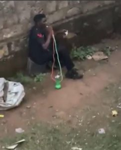 Watch 'Nigerian Police Officer' Smoking Shisha And Drinking While On Uniform (Video)
