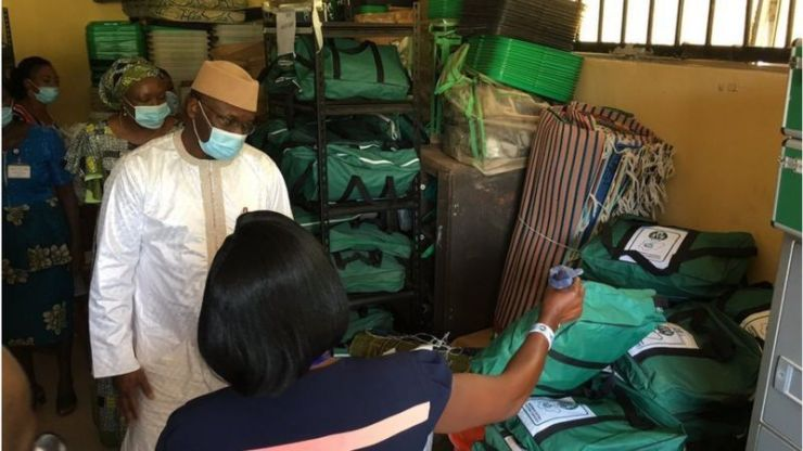 INEC Chairman, Prof. Mahmood Yakubu inspecting equipment at the agency's office in Ifedore Local Government Area of Ondo State