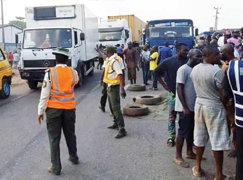 Truck Falls Sideways, Causes Major Gridlock In Owode, Mile 12