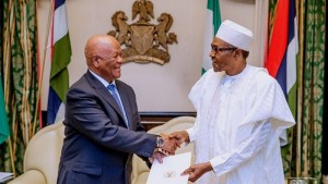Jeff Radebe handing over the apology letter to Buhari