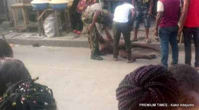FB IMG 1514374353517 300x168 - 9JA NEWS: Photos: Two soldiers caught on camera beating a commercial tricycle rider in Lagos after stripping him naked, threatens to cut off his penis