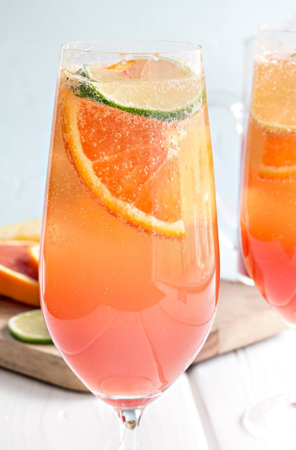 a single close up glass of planters punch where you can see all the bubbles in the glass!