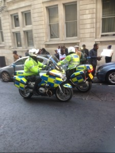 London police arrive at the scene to keep the peace