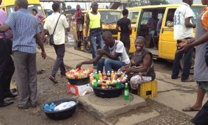 Bola Jimo, 40, and her son sell small snacks and drinks in Ikeja, central Lagos.