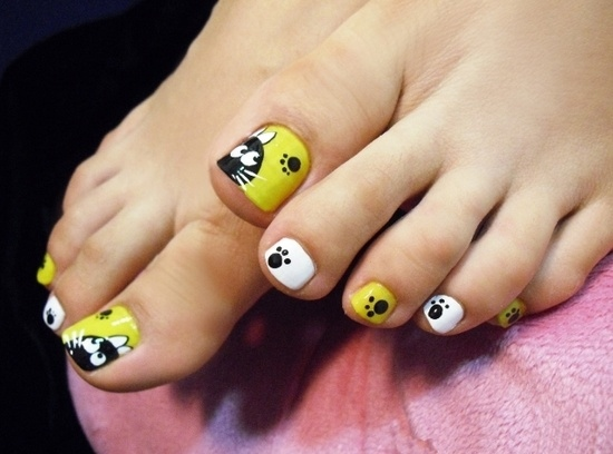 Yellow and black Easter nails
