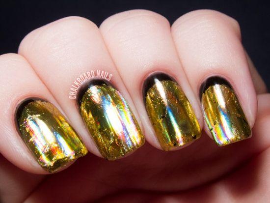 Shimmering Gold And Black Foil Nail Art