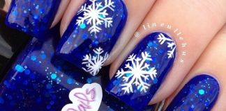 Snowflakes On Blue Gel Nails