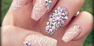 Swirls And Swarovski Crystals Nail Design