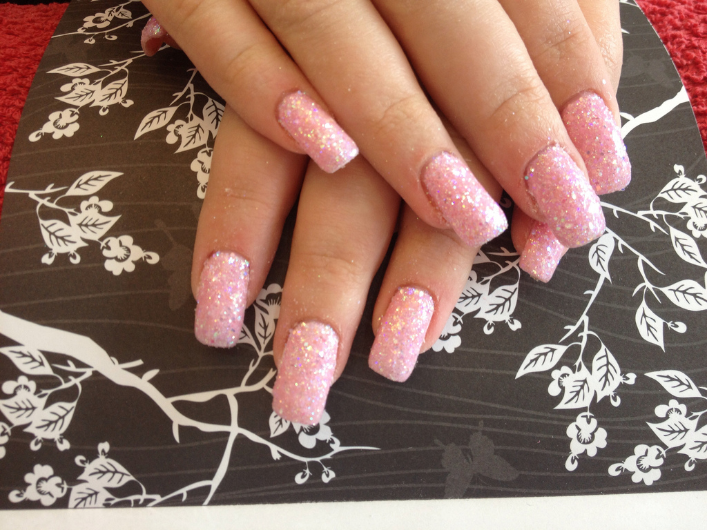 Gel Nails With Pink Polish And Glitter Dust