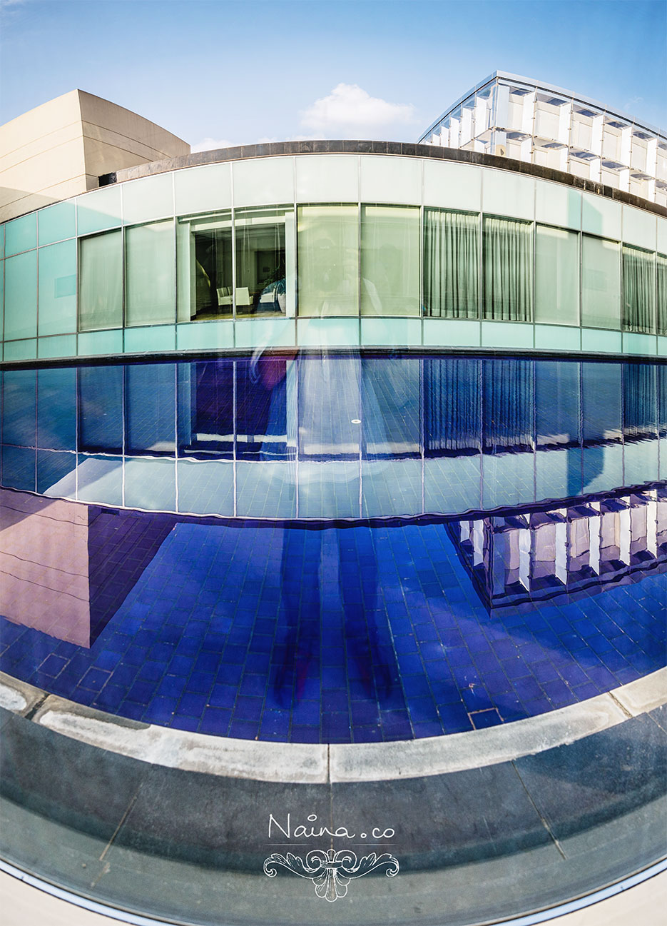 The Oberoi Hotel, Gurgaon. Blue tiles, water and blue skies. Photography by photographer Naina Redhu of Naina.co