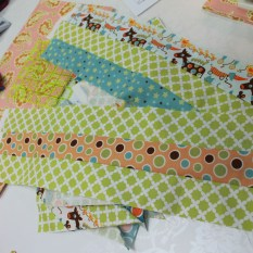Two pieces made with three strips - one of 2 patterns and 1 green and the other of 2 green and one pattern Sewn to avoid the 'banana effect'
