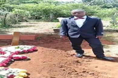 man burying wife