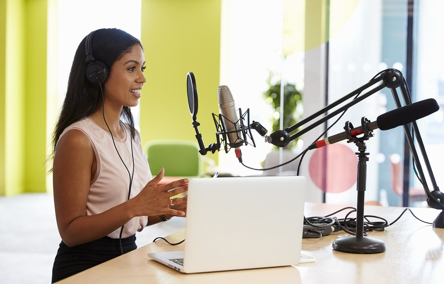 woman podcasting at her desk